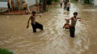 Kids enjoying swim in rain water Streets turned into swimming pools