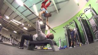 Guy benches a human handstand