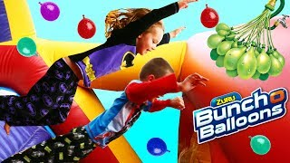 CRAZY KIDS JUMPING OFF BOUNCE HOUSE 😱Bunch O Balloons Obstacle Course Water Fight