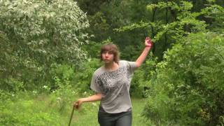 Young woman dancing on grass