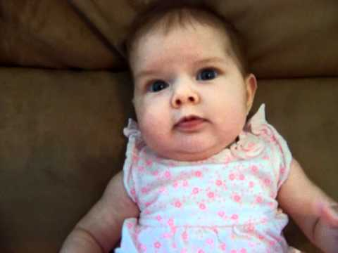 Cute 3 month old baby girl smiling and blowing bubbles - Londyn