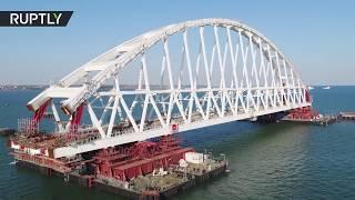 Russia installs Crimea bridge railway arch in 'unique operation' (DRONE FOOTAGE)