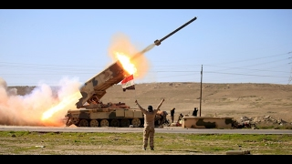 As battle in Mosul rages on, Iraqi forces bomb ISIS in Syria
