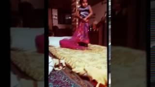 Cute girl wearing sari by herself like young women