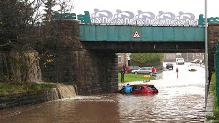 Homes and roads flood after heavy rain in Lancashire and north Wales