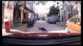 Dashcam footage catches mentally ill woman faking accident, Jinhua China