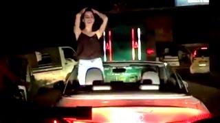 Beautiful Indian girl dancing in open car.LATEST