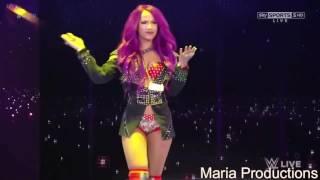 Sasha Banks enters the arena with Paige's theme song