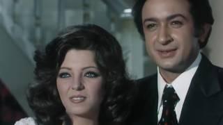 نور الشريف و هدي رمزي و مشهد من فيلم امرأتان