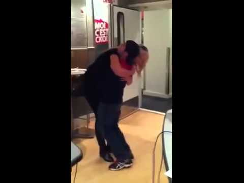 Much taller girl dances with a short guy and lifts him