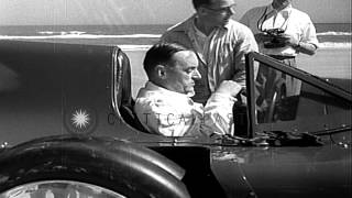 Sir Malcolm Campbell Sets A Speed Record In His Bluebird Car At Daytona Beach, Fl...HD Stock Footage