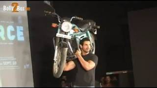 John Abraham lifts bike on shoulder