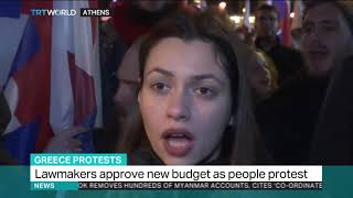 Protest in Greece as lawmakers approve new budget