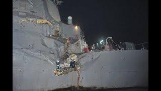 Ten missing after US destroyer collides with oil tanker