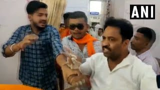 NCP man shows black flag to Sadhvi Pragya, thrashed