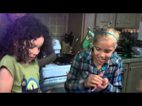 Garndma and kids making meatballs