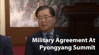 Two Koreas adopt military agreement