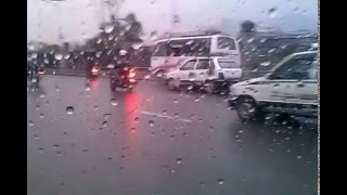 Kathmandu road and traffic during rainfall in April