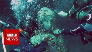 The statue saving a coral reef in the Philippines - BBC News