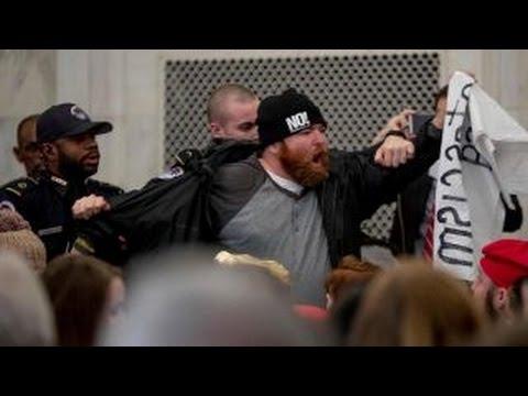Protests interrupt Sen. Sessions at confirmation hearing