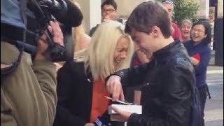 First person to buy iPhone 6 in Perth drops it on live TV when pressured by reporters.