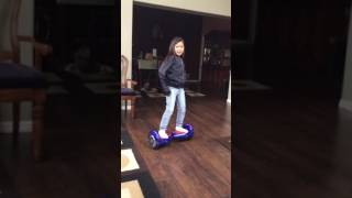 Little girl dances to Loca by Shakira on hoverboard