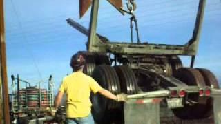 Loading an empty logging trailer on a Peterbilt.