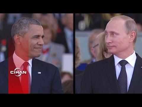 Putin ve Obama'nın göz göze geldiği ilginç an (Perforeli)