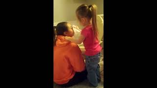 Little sister takes care of big sister puking