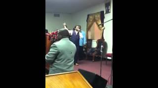 Pastor E. Johnson preaching at nmoc
