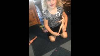 Lil girl trying to pop a balloon with a nude doll