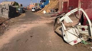 فضيحة: عون سلطة يشجع انتشار الازبال وسط الشارع العام بالحي الصناعي سيدي غانم بمراكش