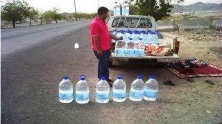 ضبط عمالة تزور عبوات ماء زمزم