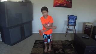 young boy learning to break dance on his own