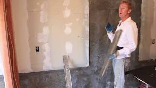 Plaster rendering over interior concrete and drywall