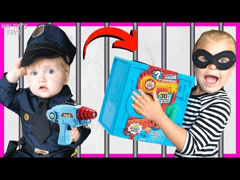 Kin Tin opens Ryan s World Super Surprise Safe Cops and Robbers Police Chase and Jailbreak