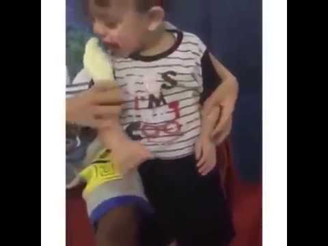 Small Boy Tries To Eat Live Bird