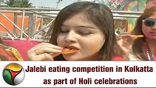 Jalebi eating competition in Kolkatta as part of Holi celebrations
