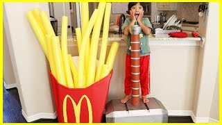 Kid eats Giant McDonald