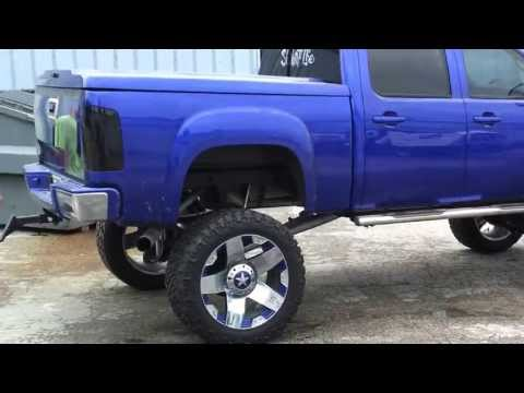 Candy Cobalt Blue GMC 1500 lifted on 38s with 24
