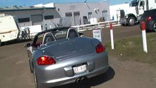 A Manual Porshi Bangla Car Starting Up and Driving Off from the Whitemud Amusement Park Edmonton