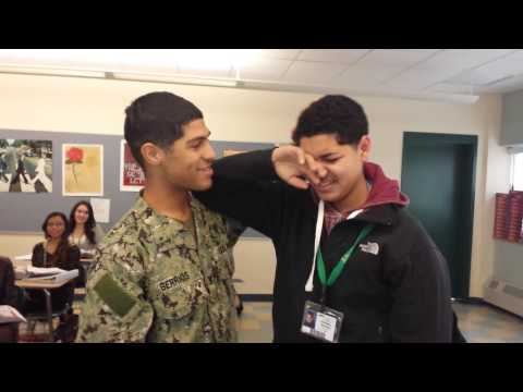 Military brother surprises little brother at school