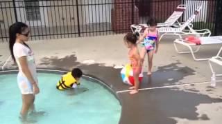 Rihanna having fun playing in the pool