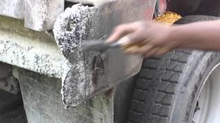 Clean asphalt off dump truck tailgate