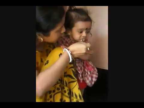 Mother is feeding her Cutey Baby