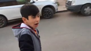 Middle Eastern Kid Imitates A Police Siren Sound