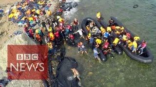Drone video shows migrants