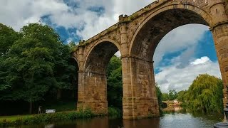 Ancient Railway Viaduct Over River Stock Video