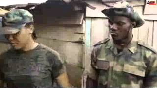 A soldier asking a warri boy questions