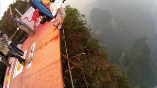 Wingsuit Red Bull event,base jumps off the dragon wall and Jeb flies through the hole